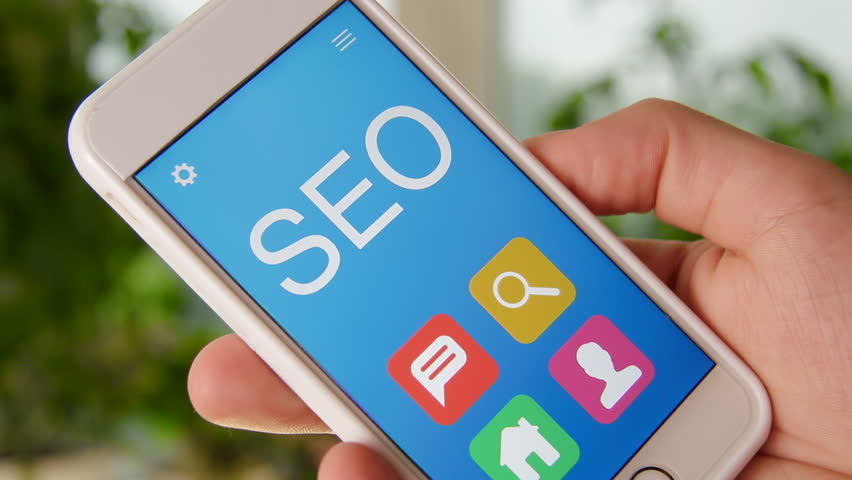 SEO concept application on the smartphone. Man uses mobile app. | Shutterstock HD Video #28554523