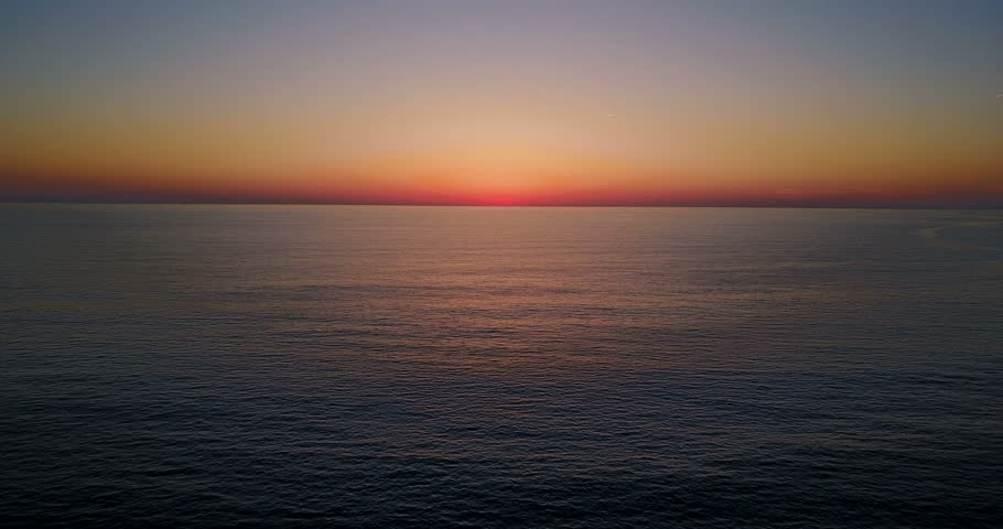 Brightly colored sunset over the calm Mediterranean Sea. Drone Point of View . Night	  | Shutterstock HD Video #28562137