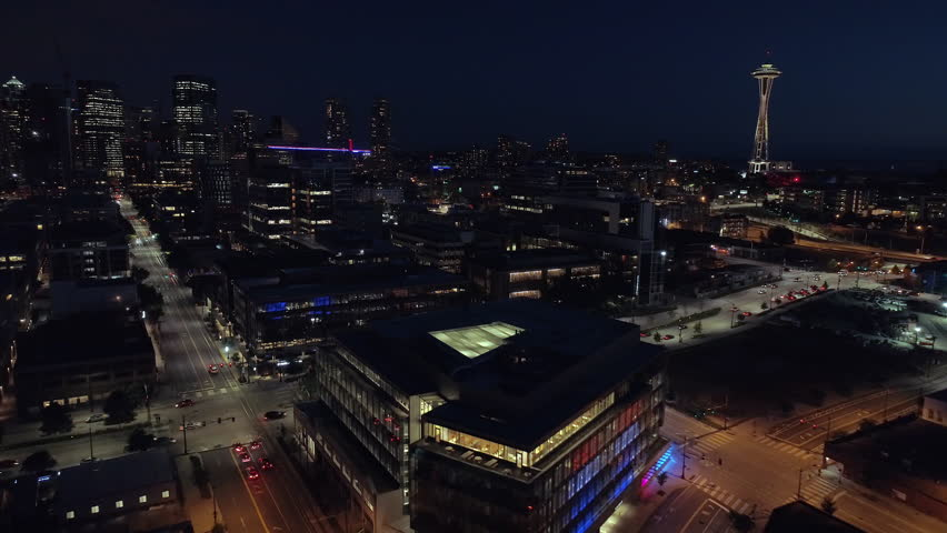 Aerial of Downtown Seattle Lit at Night with Cars Driving on City Streets