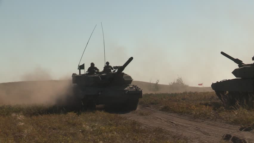 CALGARY, ALBERTA - CIRCA 2012: Leopard 2A4 tank driving on dust track past tank