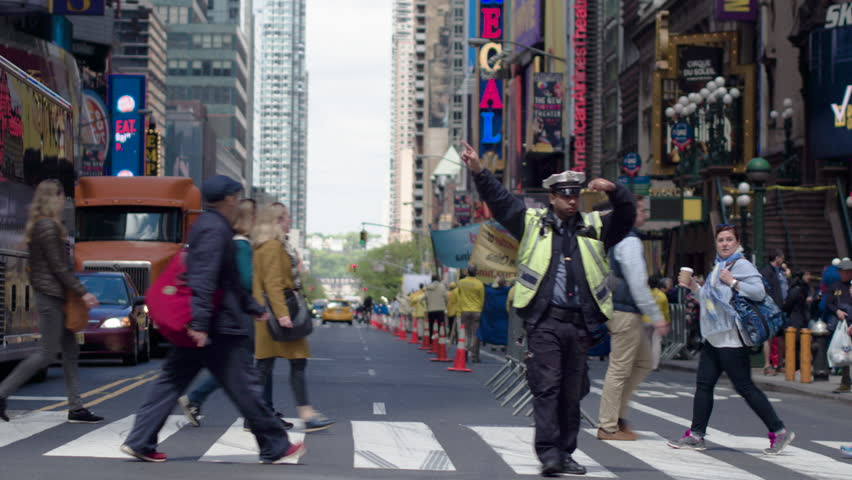 New York, Usa, 05.05.2017. Car traffic in Manhattan. The New York Police Department regulates traffic. Dolly shot.