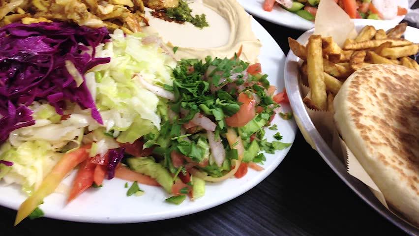 Shawarma, schnitzel, salads, hummus & tahini at an Israeli restaurant
