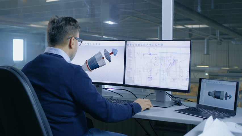 Chief Male Engineer Designs on 3D Model of a Turbine or Engine Part. Second Screen Shows Technical Blueprints. Out of the Office Window Big Factory is Seen. Shot on RED EPIC-W 8K Helium Cinema Camera. | Shutterstock HD Video #28698307