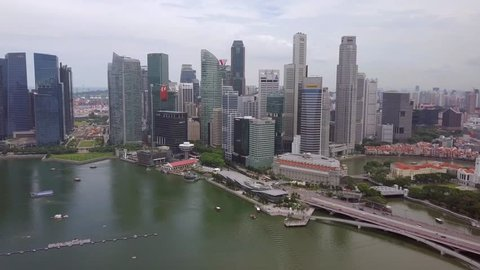 Travelling drone shot of Singapore City Skyline with sky scrapers in the background  - Singapore July 2017
