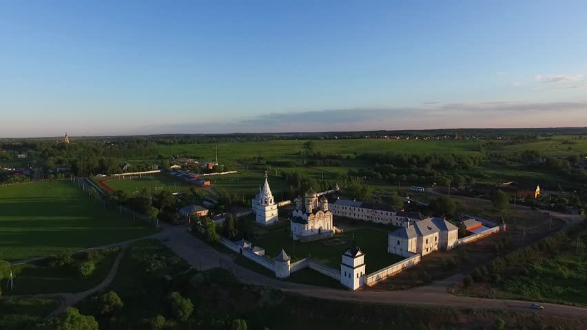 Aerial Top view of Church and green fields on a Sunny day