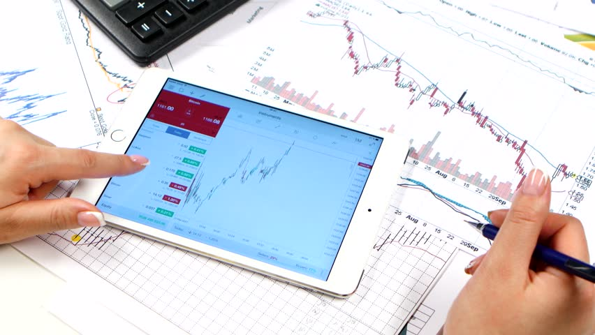 Hands of woman scans on tablet online stock market. Trading   Shutterstock HD Video #28726057