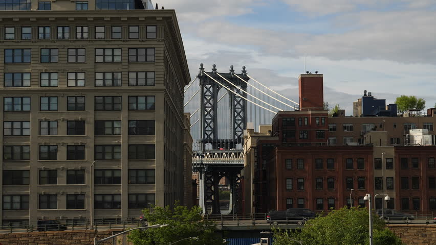 New York City, May 2017. Manhattan bridge seen through buildings in Brooklyn.