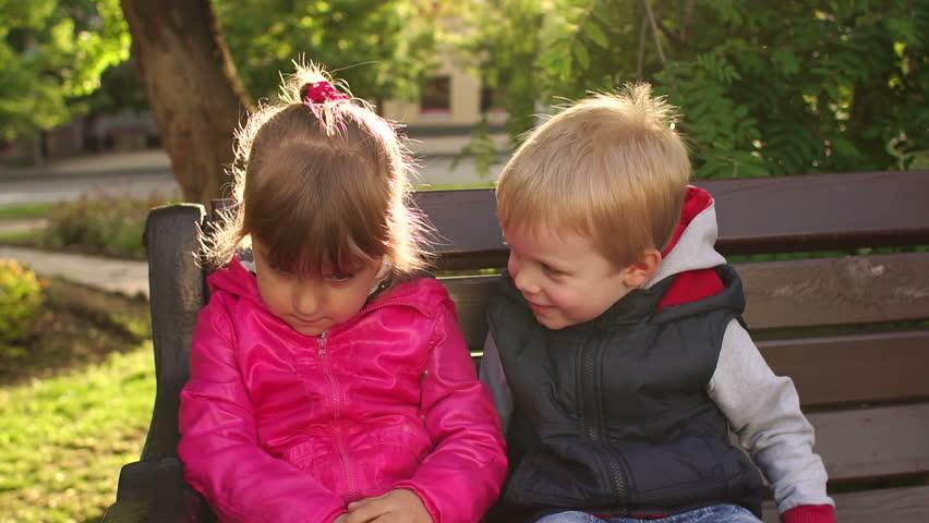 Fun Boy Three Or Four Years Kissing Sad Girl Outdoors -7780