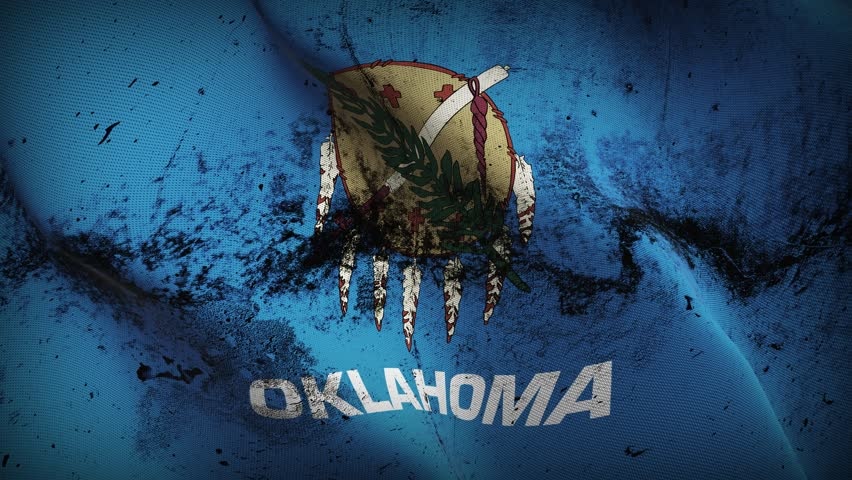 Oklahoma US State grunge flag waving seamless loop. United States of America Oklahoma loopable dirty flag with highly detailed fabric texture.