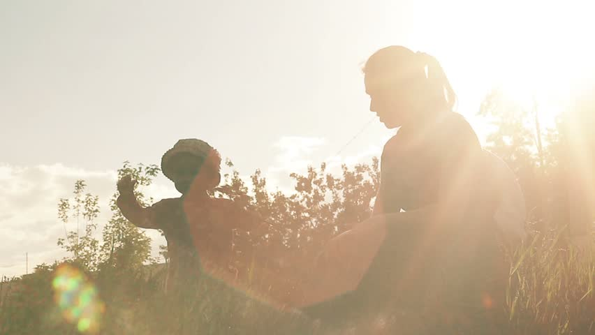 Happy mom playing with baby girl. Silhouette | Shutterstock HD Video #28749397