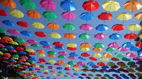 Lots of umbrellas coloring the sky. Umbrella Sky Project in Torremolinos, Spain.