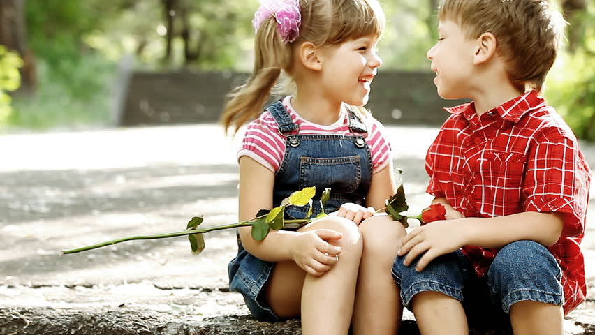 Stock video clip of two children speaking and boy presents flower stock video clip of two children speaking and boy presents flower shutterstock thecheapjerseys Images