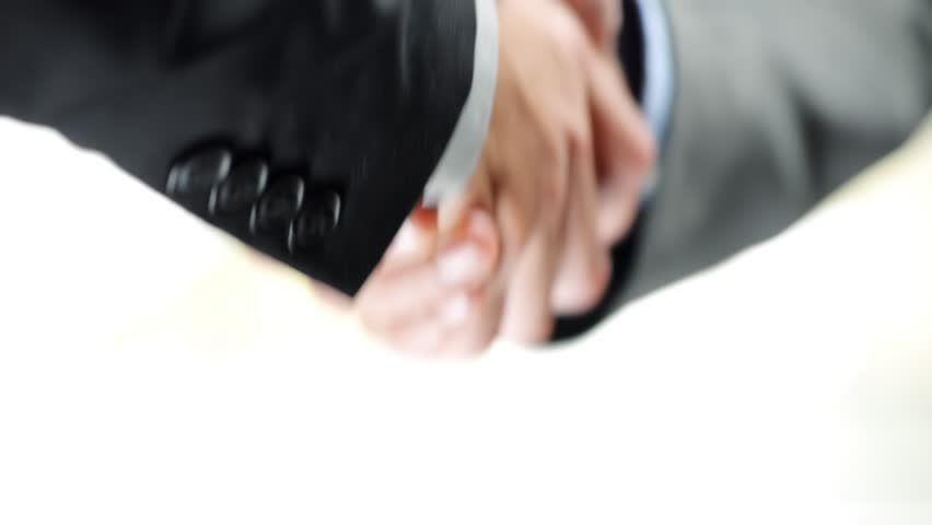 Business Handshake two businessman shaking hands closeup motion track high definition