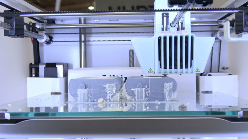 Hannover, Germany - March, 2017: 4K video footage of 3d printer iGo 3d Ultimaker printing close up process on exhibition Cebit 2017 in Hannover Messe, Germany | Shutterstock HD Video #28783609