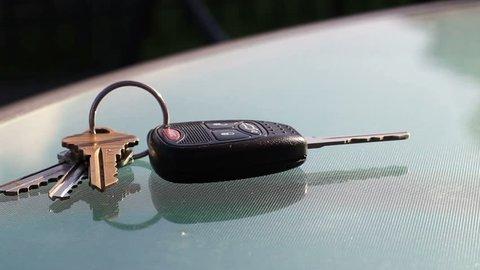 Man picks up car keys from restaurant table in summer