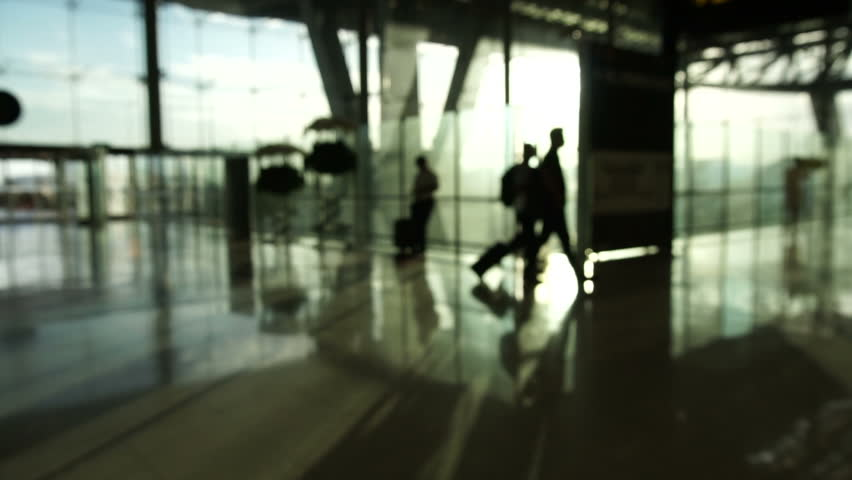 Blur crowd of people silhouette walking in airport with glass structure and sunrise background. Abstract business and traveler | Shutterstock HD Video #28859707