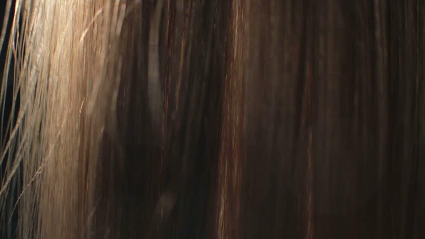 Combing long hair closeup