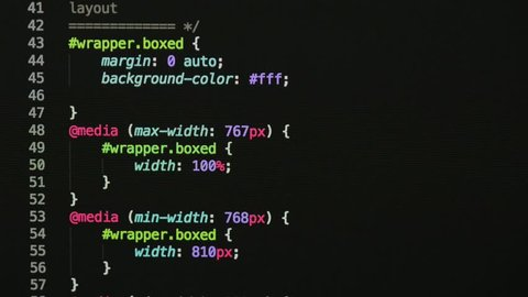 HTML and CSS code developing. Website design code programming on a laptop screen.