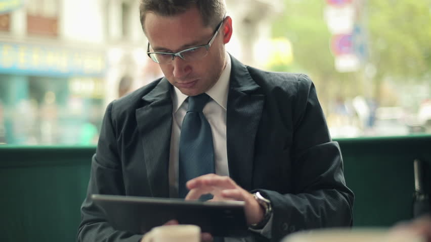 Young businessman with tablet in restaurant, outdoor    Shutterstock HD Video #2894119