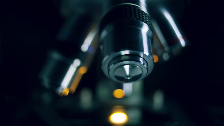 Optical Microscope in dark backround. Microscope is used for conducting planned, research experiments, educational demonstrations in medical and clinical laboratories. | Shutterstock HD Video #28947547