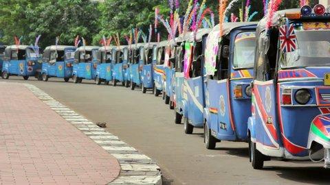 closeup of colorful tuktuk in Jakarta, Indonesia