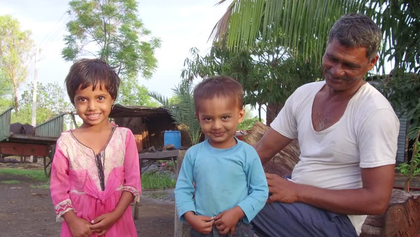 Fifty year old Indian man with grand son and daughter in the morning in rural village Salunkwadi, Ambajogai, Beed, Maharashtra, India, Southeast Asia | Shutterstock HD Video #28974910