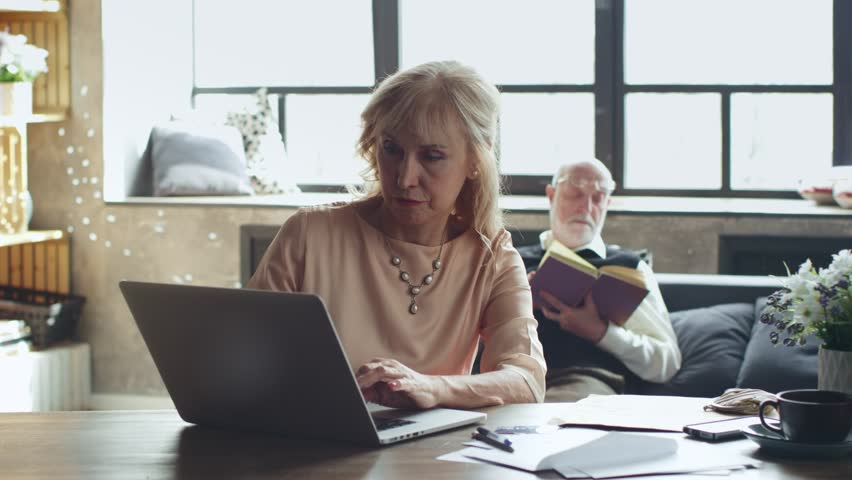 Modern elderly couple won an online lottery. they rejoice
