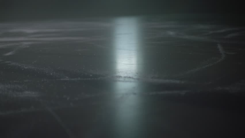 point of view skating in hockey arena rink puck on ice in slow motion