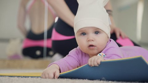 Small Child Lies On Gym Stock Footage