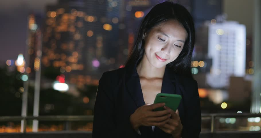 Business woman use of cellphone at night  | Shutterstock HD Video #29064787
