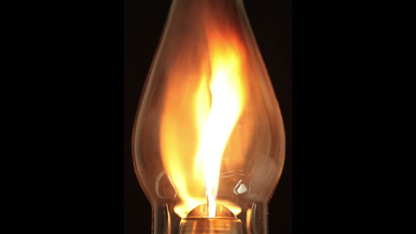 Close-up of a lamp bulb burning over a black background. Burns intensely in the beginning then decreases. Segments are easily loopable.