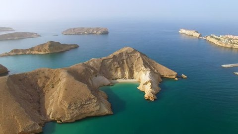Aerial view of Muscat bay, dive resort, day trip and relaxing area, islands of Indian ocean, beaches and  blue lagoons, Oman, sultanate on Arabian Peninsula, 4k UHD