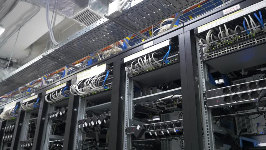 Row of bitcoin miners set up on the wired shelfs. Computer for Bitcoin mining. cables plug to motherboard for mining machine. Cryptocurrency computer with many peripheral slots