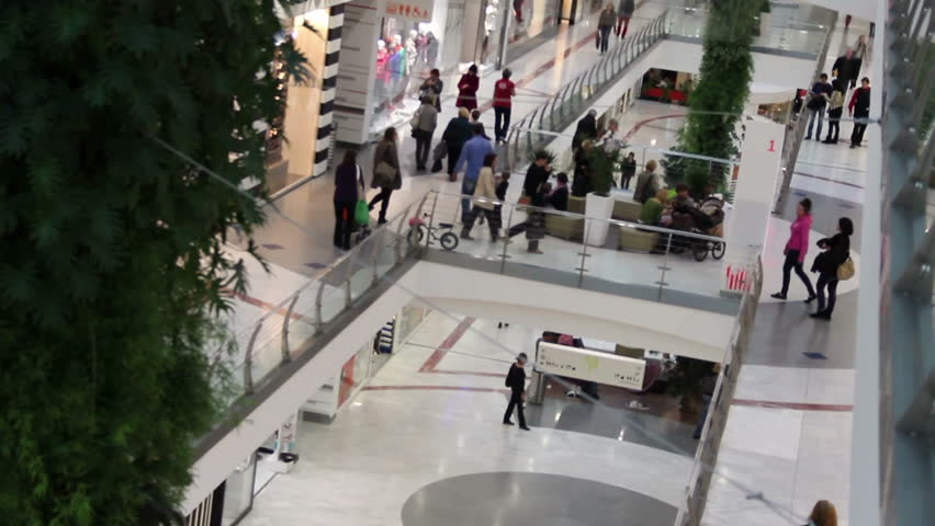 walking crowd inside of shopping mall (unrecognizable people)