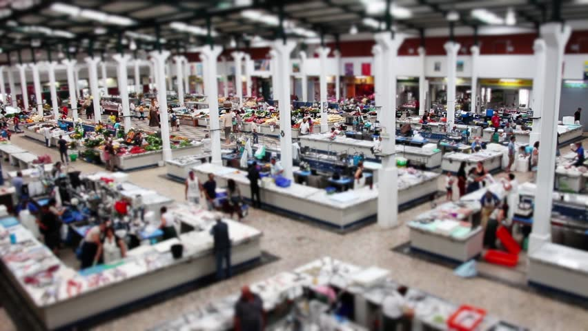 Crowded Farmers Market Time Lapse Tilt Shift. SETUBAL, PORTUGAL - 16 JULY 2017; Top view of a huge farmers market with crowd on a busy day