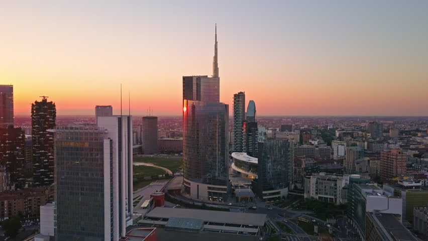 Milan, JAN 05, 2017:city of milan  aerial view at sunrise flying over city