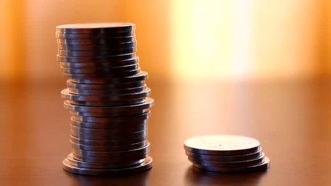 Cheap vs. expensive, coins on a desk, savings, choice
