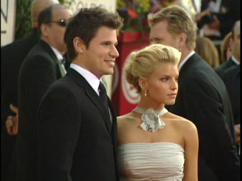 Beverly Hills, CA - JANUARY 25, 2004: Nick Lachey, Jessica Simpson, walks the red carpet at the Golden Globe Awards 2004 held at the Beverly Hilton Hotel