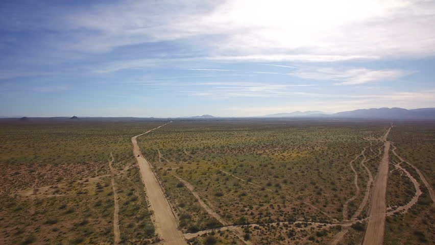 Desert Dirt Road Aerial Shot of African Svanna or Mid East