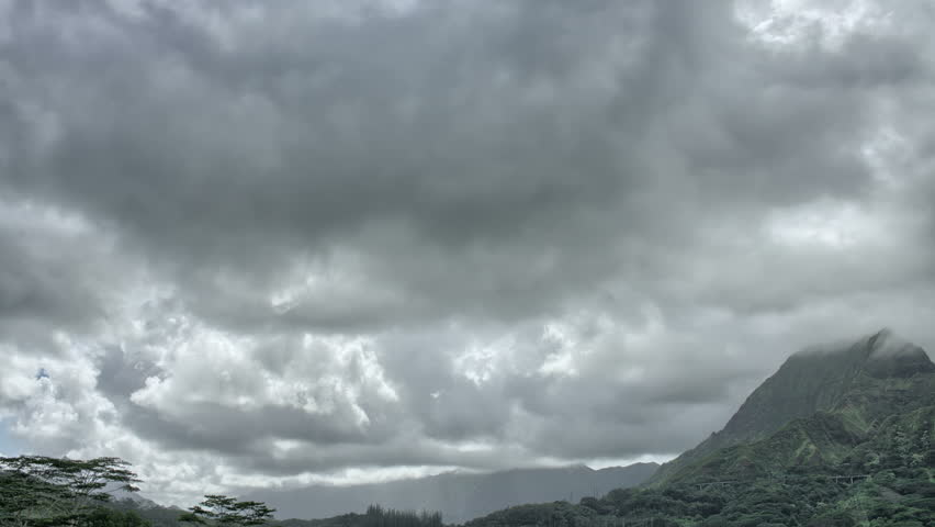 White clouds move across clear blue sky cloudy blue sky oahu hawaii mountain range hdr time lapse hd stock video clip altavistaventures Gallery