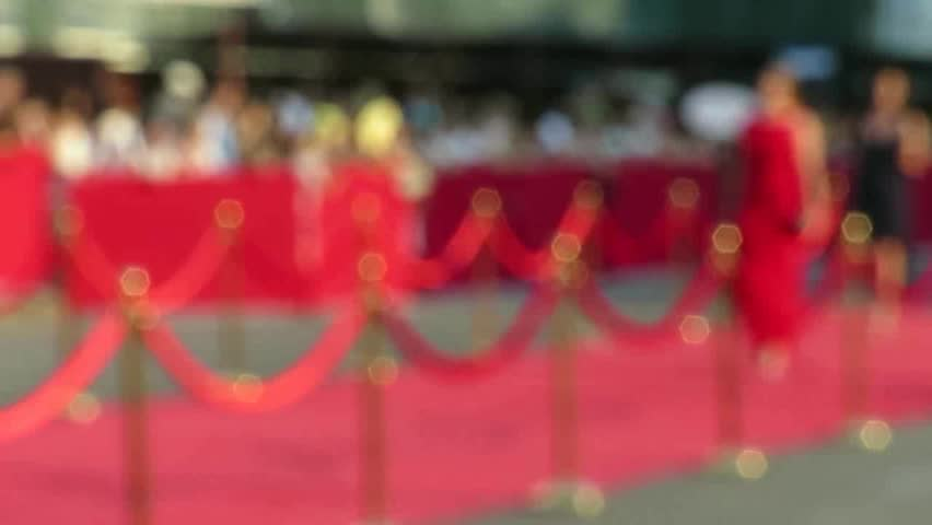 Blurred video. Red carpet entrance with golden stanchions and ropes. Celebrity nominees go to the premiere. Stars on the festive awarding of prizes awards | Shutterstock HD Video #29211337