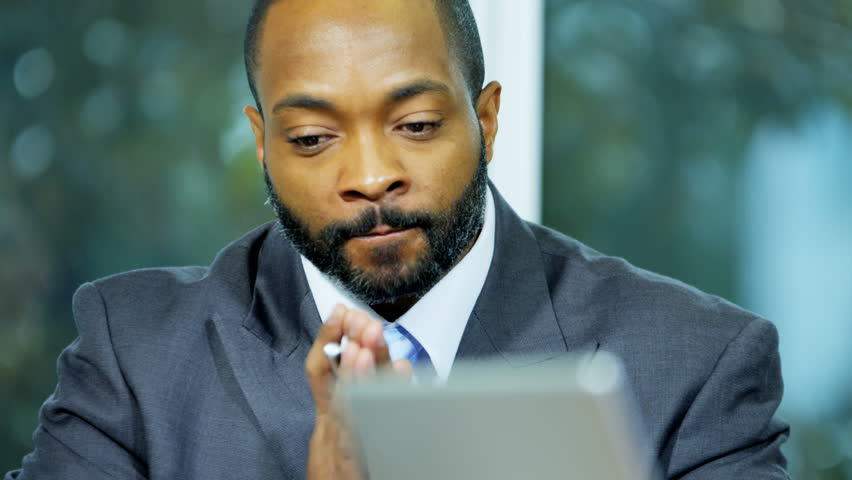 Confident ethnic male business financial advisor leading meeting in boardroom   | Shutterstock HD Video #29224777