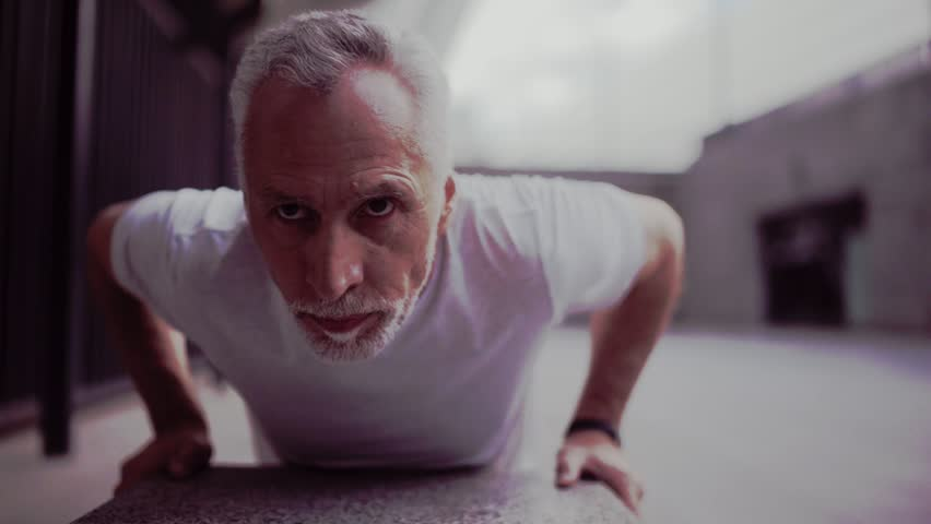 Persevering senior man doing push ups | Shutterstock HD Video #29227267