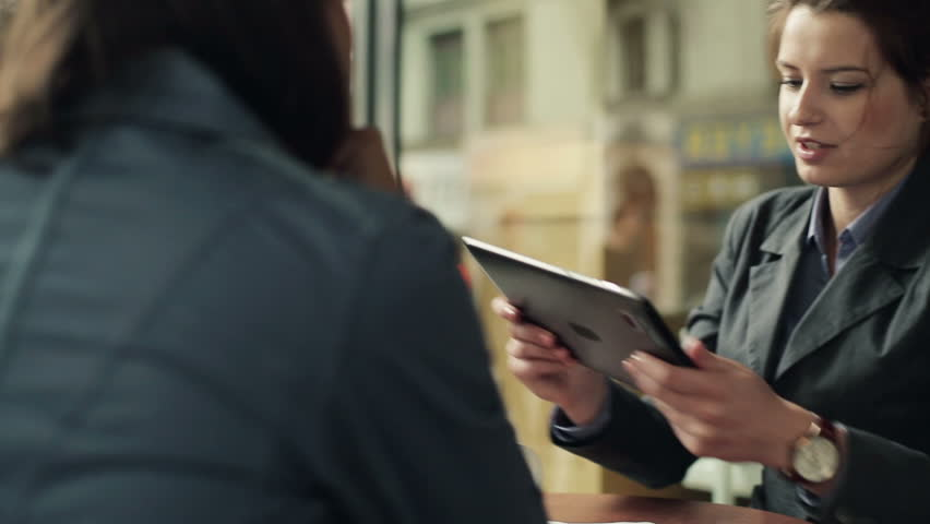 Young business people with tablet computer in cafe, steadicam shot | Shutterstock HD Video #2931904