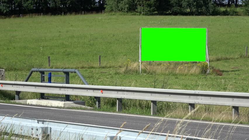 View of billboard stands next to road. Outdoor advertising space. Countryside. (green screen)