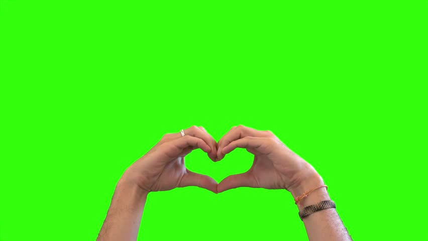 Hands doing Love Sign On Green Screen. Hands making a love sign over a green screen background #29328967