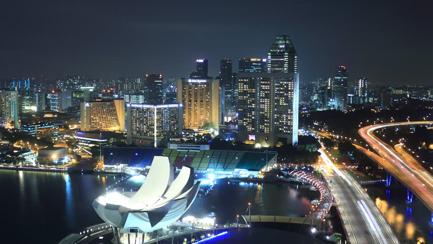 EL: Marina – Singapore January 10 2012: Time Lapse Singapore at Night. View to Marina in Singapore on January 10 2012