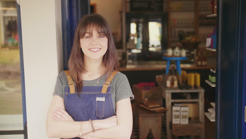 Portrait Of Smiling Deli Owner Standing Arms Crossed Outside Store