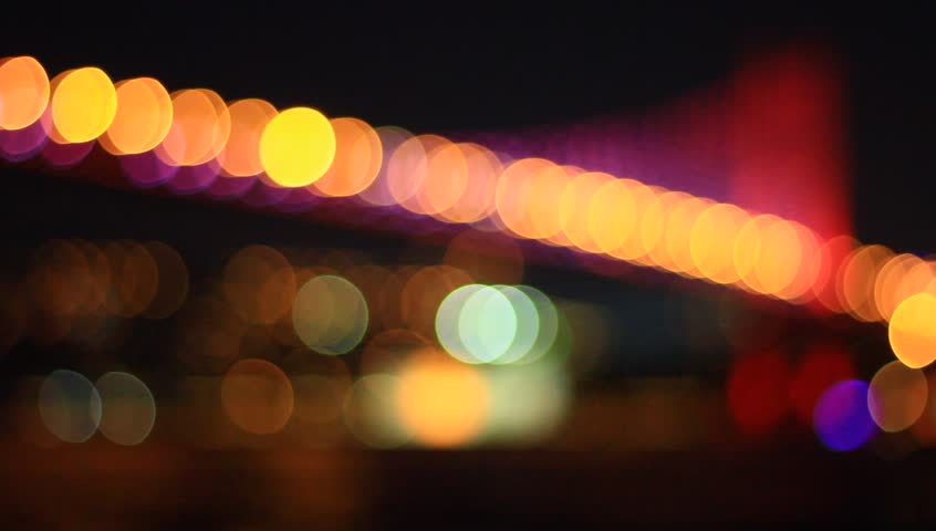 Bosporus bridge with red led lights on. Focusing in