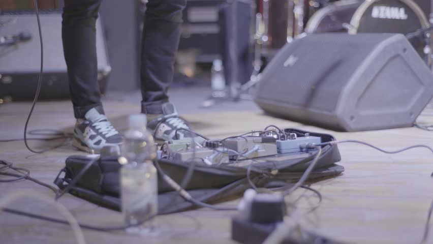 The foot of the musician presses the pedal on the stage | Shutterstock HD Video #29426317